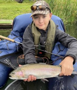 Cameron Craik catching at Kinross Trout Fishery Scotland